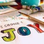 choose joy painted on paper