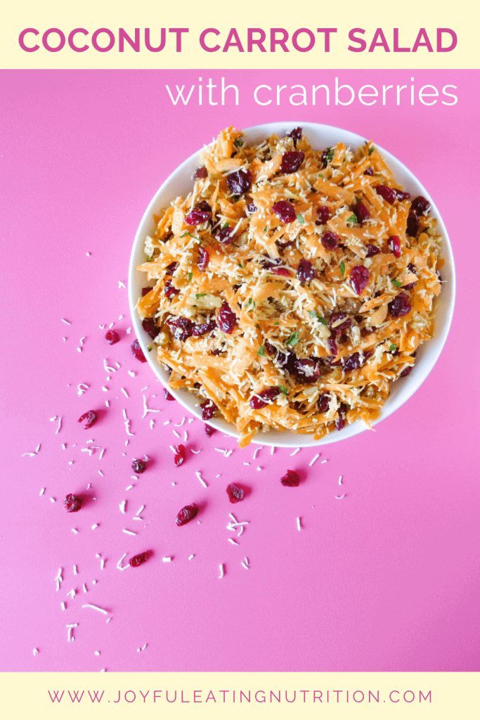 Coconut Carrot Slaw Salad in white bowl on pink surface with title text