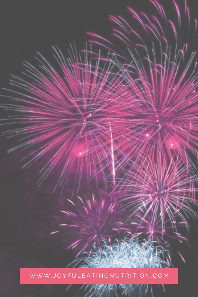 pink fireworks on a black background
