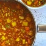 pot and bowl of pasta-free minestrone soup with barley