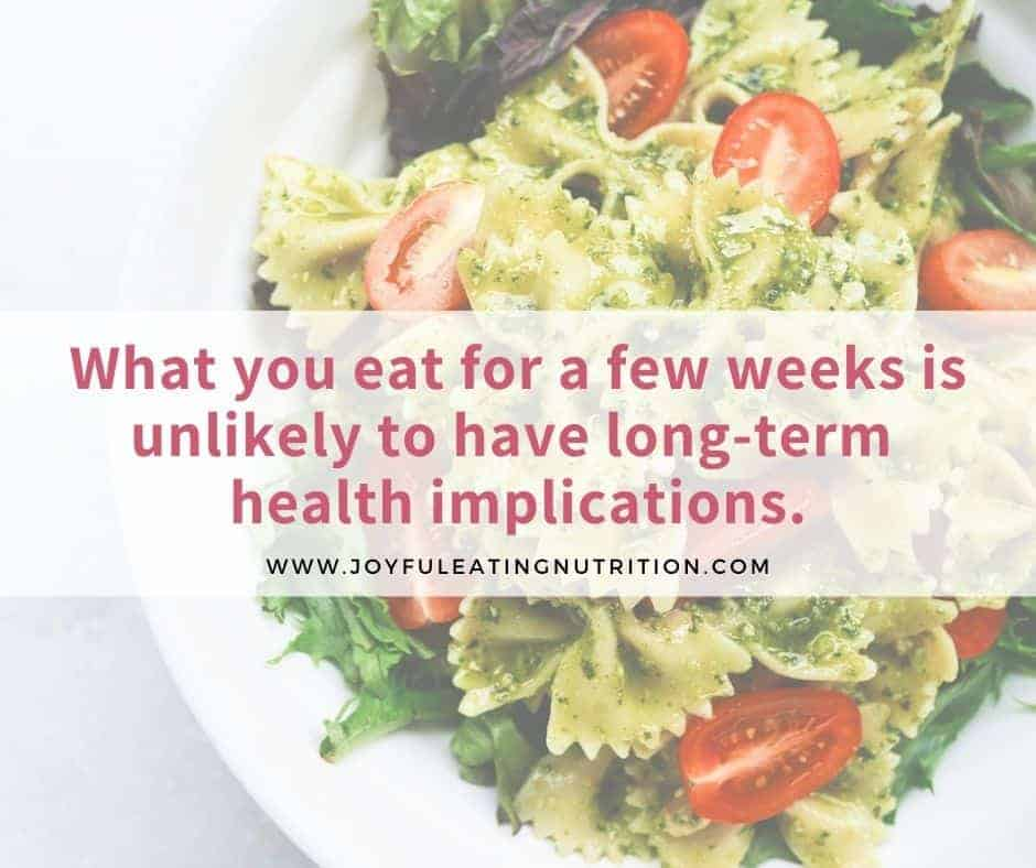 pesto pasta with text explaining that short-term eating is unlikely to have long-term consequences