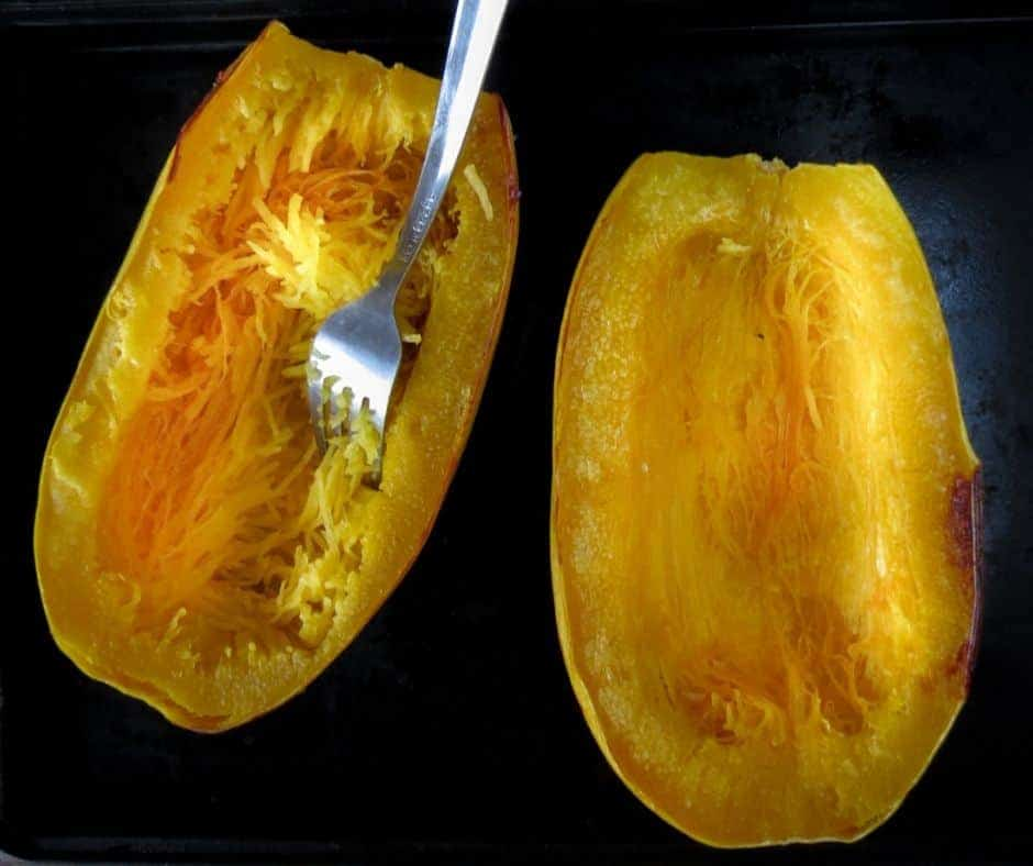 cooked spaghetti squash with fork to create 'noodles'
