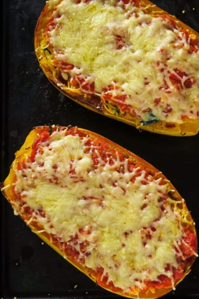 two Spaghetti Squash Lasgana Boats on black baking tray