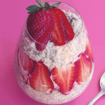 Chia seed pudding in a cup with strawberry slices
