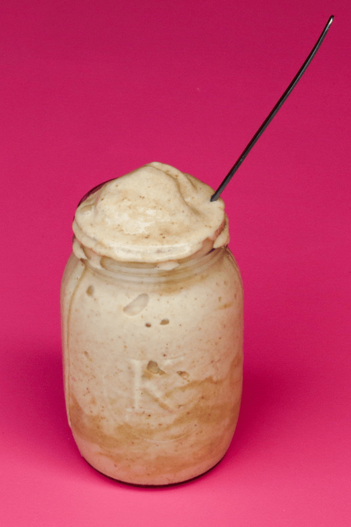 glass with frappe on pink background