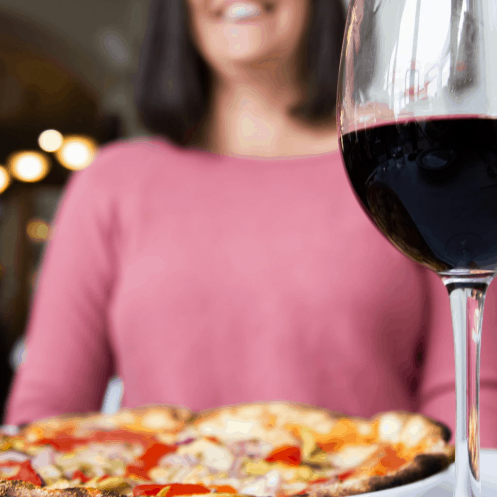 Tansy with a pizza and glass of wine